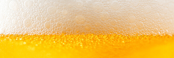 Light Beer with Bubbles and Foam Background. Beer Bubbles Texture Close Up
