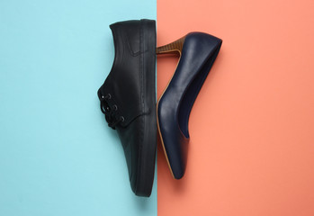 Male and female leather shoes on colored  background. Top view