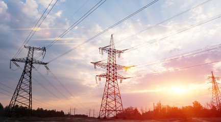 High-voltage power lines at sunset or sunrise. High voltage electric transmission tower Fotomurales