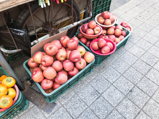 boxes with fresh pink apples at market in Sokcho