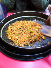 portion of fried rice in frying pan in local cafe