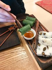 eating sweet tteok (korean rice cake) in teahouse
