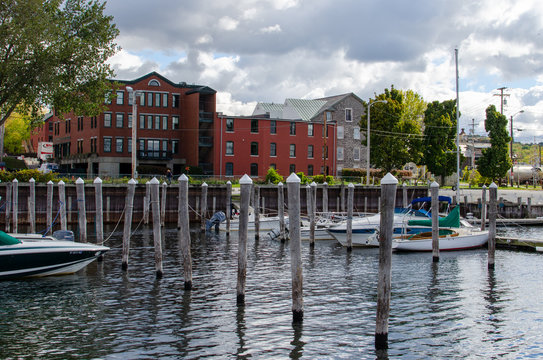 Harbor with boats on lake red building wooden poles