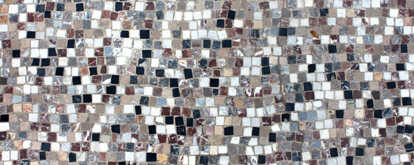 Mosaic of black and white tiles