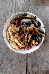 Mediterranean Seafood dish of Mussels, fish, and shrimp flat lay