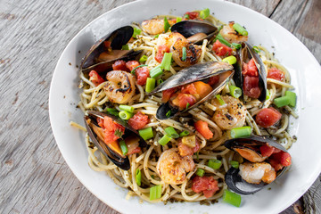 Mediterranean Seafood pasta dish of Mussels, fish, and shrimp flat lay