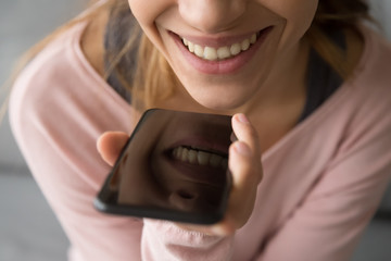 Close up of smiling girl talking on smartphone