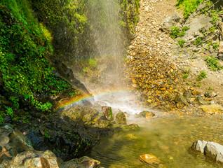 Fotobehang Bossen A perennial roadside waterfall and a rainbow, Mussoorie, Uttarakhand, India