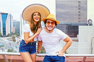 Portrait of stylish young couple on terrace, Mexico City, Mexico