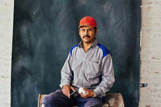 Studio portrait of construction worker
