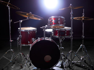 Staande foto Vlam drum set isolated over dark background with lights