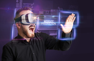 Businessman looking through Virtual Reality glasses with WEBSITE PRODUCTION inscription, new technology concept