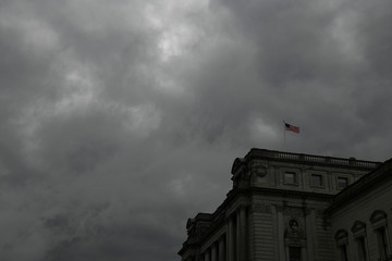 An American flag waves in the wind atop the Library of Congress on Capitol Hill in Washington