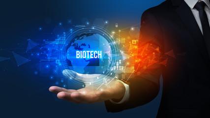 Elegant hand holding BIOTECH inscription, digital technology concept