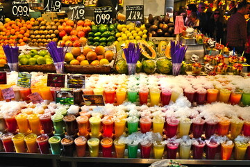 Ready to eat fruit salad in plastic container at La Boqueria Market in Las Rambas, Barcelona, Spain)