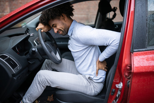 Driver Standing Having Backpain