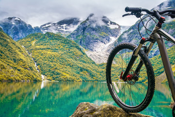Mountain bike on the background on amazing Norway landscape. Artistic picture. Beauty world.