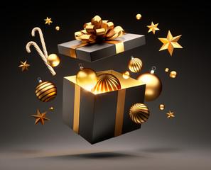 Offene Geschenkbox in Gold und Schwarz mit Weihnachtsschmuck