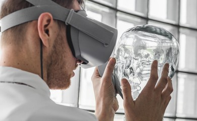 Person wearing virtual reality goggles holding a transparent mannequin Wall mural