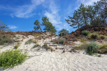 Stairs on a beach over Baltic Sea located between villages of Mrzezyno and Pogorzelica in Poland