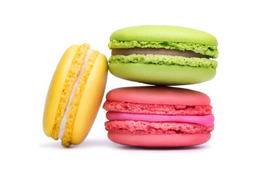Foto auf Leinwand Macarons Yellow, pink and green macaron cookies isolated on white background