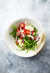 Arugula and cherry tomato salad with feta and red onion