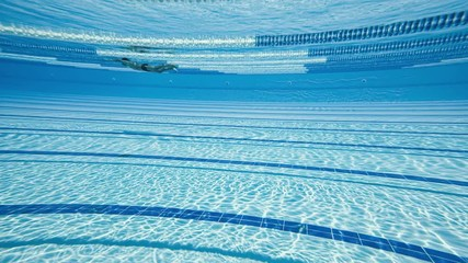 Fototapete - Swimming pool under water background.