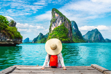 Traveler woman looking amazed nature scenic landscape tropical island Phang-Nga bay Adventure lifestyle tourist travel Phuket Thailand summer holiday vacation  Tourism beautiful destination place Asia Fotomurales