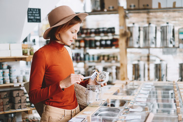Woman buying products in plastic free grocery store