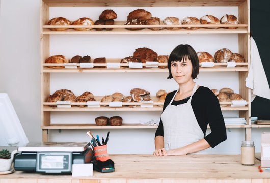 Local business owner or bakery worker behind the counter