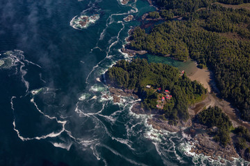 Wall Mural - Aerial Landscape View of Beautiful Pacific Ocean Coast during a sunny summer morning. Taken at Pacific Rim National Park, South of Tofino and Ucluelet, Vancouver Island, British Columbia, Canada.