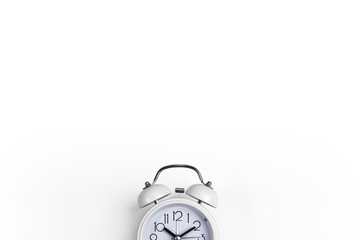 A white alarm clock on a white background. a top view. a picture with a space for writing letters