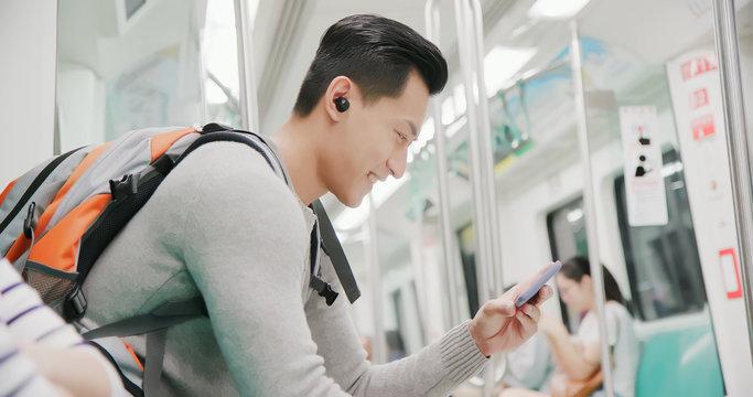 asian man wear wireless earbuds
