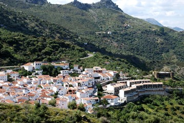 Elevated view of the white town and mountains, Benadalid, Andalusia, Spain.