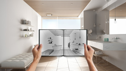 Hands holding notepad with creative bathroom design blueprint sketch or drawing. Real interior design project background. Before and after concept, architect designer work flow idea Fotomurales