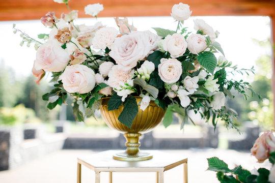 beautiful vase of roses. wedding decor. luxury bouquet