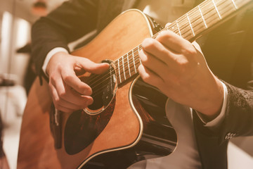 Acoustic guitar playing. A man playing an acoustic guitar.