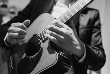 black and white photo of a musician playing guitar