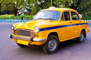 Local yellow taxi waiting for passengers in taxi stand near Victoria Memorial. Yellow taxi is...