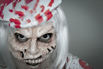 Woman dressed as a killer nurse for Halloween