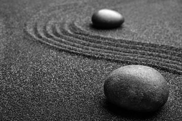 Photo sur Plexiglas Zen pierres a sable Black sand with stones and beautiful pattern. Zen concept