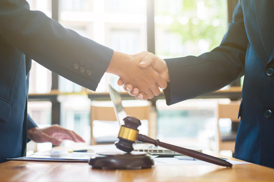 Business people shake hands after legal consultation from a lawyer.