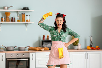 Portrait of aggressive pin-up woman going to clean kitchen