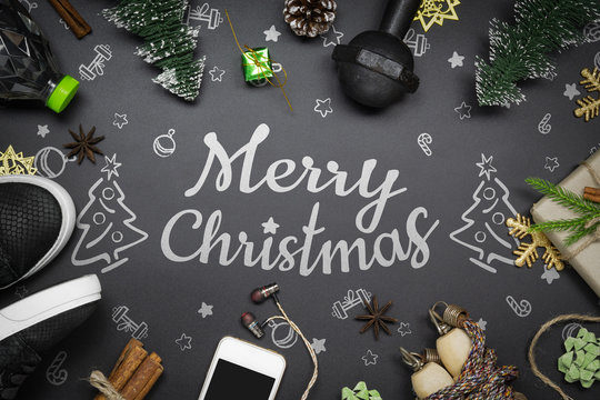 Fitness and Healthy Christmas sport composition concept. Top view of sport shoes, dumbbells, skipping rope and Christmas ornaments for Merry christmas and Happy new year fitness healthy lifestyle.