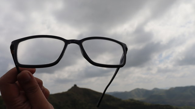 Spectacles raised high in the sky. Cloud computing and Big data with Amazon web services and google cloud platform.