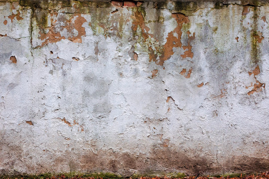 old white wall with cracks. abstract ruin architecture texture. devastation background concept