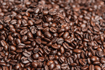 Close up pile of roasted coffee beans, shallow depth of field.