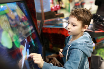 Child playing game on touchscreen
