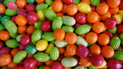 Delicious fruit sweets.  Colorful fruit dragees, oranges, melons, cherries, lemons, with soft filling. Close-up.