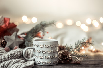 Festive background with Cup on wooden background with lights.